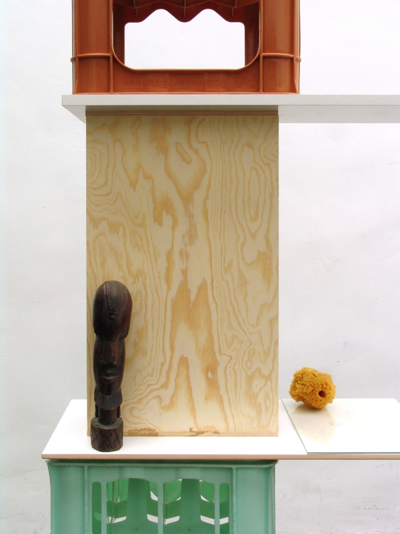 'The Dormouse's Dream (Monument)', details: bottle boxes, flagging, glass plate, formica, wood, sponge, graphite on paper, enamel on paper, wooden statue, 2015