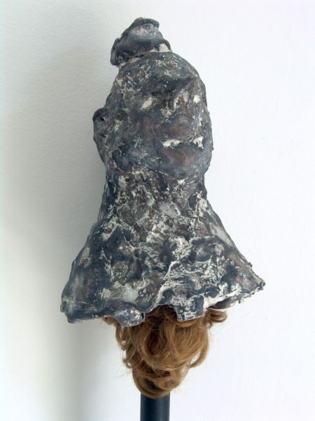 from the series 'The Vertebral and the Invertebrate', casted bronze, iron bar and wig, 13 x 140 x 10 cm, 2007